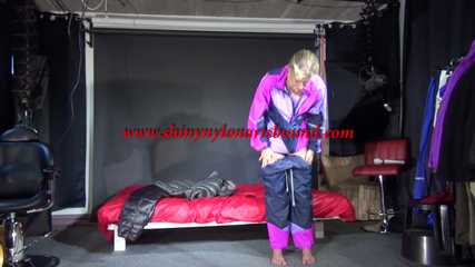 Watching Pia changing clothes and wear a supersexy shiny nylon down pants and a down jacket enjoying the material (Video)
