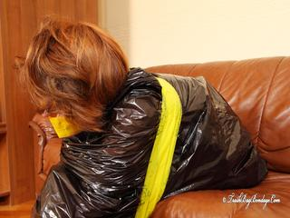 [From archive] Stella - taped sitting with yellow duct tape and packed into trash bag