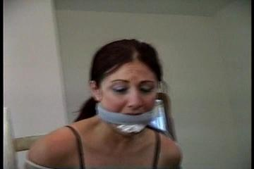 34 YEAR OLD HOTEL MANAGER GETS  MOUTH STUFFEDAND CLEAVE GAGGED 2 TIMES, HANDGAGGED AND HAS BEEN TIGHTLY TIED TO A CHAIR  (D70-7)