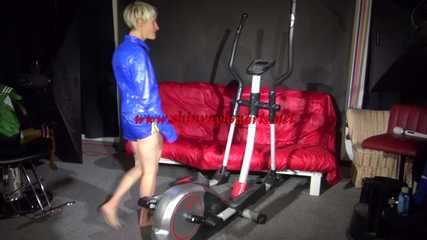 Watching sexy Sandra wearing a sexy blue/yellow shiny nylon shorts and a blue rain jacket during her workout (Video)