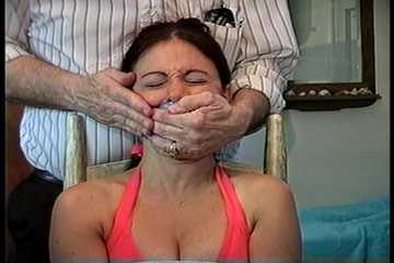 34 YEAR OLD HOTEL MANAGER IS CLEAVE GAGGED, TAPE GAGGED, HANDGAGGED, MOUTH STUFFED, OTM DOUBLE GAGGED, GAG TALKING, BAREFOOT, TOE-TIED WHILE TIGHTLY TIED TO A CHAIR (D73-18)