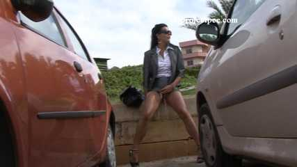 016184 Eve Stands By The Car Park Wall To Pee