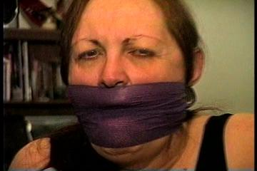 46 Yr OLD REAL ESTATE AGENT'S IS MOUTH STUFFED, HANDGAGGED, CLEAVE AND OTM VET TAPE GAGGED, BALL-GAGGED, CLEAR TAPE GAGGED WITH HANDS TIGHTLY TIED WITH THIN RAWHIDE (D72-5)