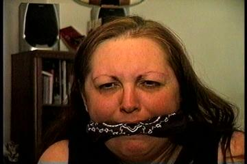 46 Yr OLD REAL ESTATE AGENT'S IS MOUTH STUFFED, HANDGAGGED, BANDANNA CLEAVE AND OTM GAGGED, ROPE GAGGED WITH HANDS TIGHTLY TIED WITH THIN RAWHIDE (D72-10)