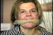 38 Yr OLD SOCIAL WORKER GETS HANDGAGGED, SOCK STUFFED IN MOUTH, MOUTH STUFFED, CLEAVE GAGGED AND TIED TO A CHAIR (D69-3) 1