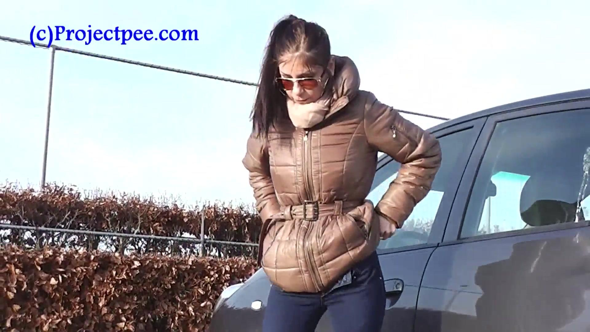 Peeing beside a car